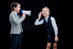 Boy with megaphone yelling on girl Royalty Free Stock Photography