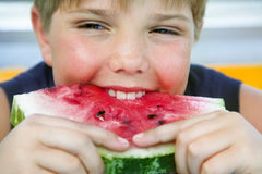 Boy with melon Royalty Free Stock Photos