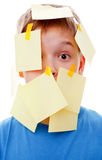Boy with memo posts on his face Stock Photos