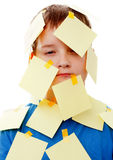 Boy with memo posts on his face Royalty Free Stock Photography