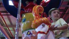 Boy on merry go round. Video stock video