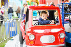 Boy on a Merry-Go-Round Firetruck Royalty Free Stock Photography