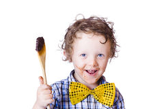 Boy messing with food Royalty Free Stock Photos