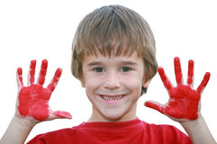 Boy with Messy Red Hands Stock Photo