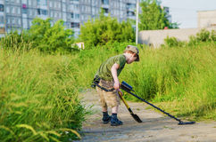 Boy with a metal detector. Looking for treasure stock images