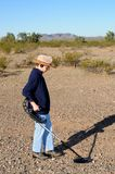 Boy with a metal detector stock images