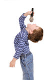 Boy with a microphone sings Royalty Free Stock Photo
