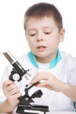 Boy with microscope Stock Images