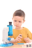 Boy with microscope Royalty Free Stock Photos