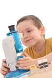 Boy with microscope Royalty Free Stock Images