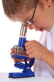 The boy with a microscope Stock Photos