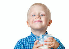 Boy with milk. Little boy with a glass of milk on a white background Stock Photography
