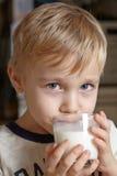 Boy with milk Stock Photos