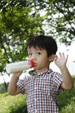 Boy with milk bottle Stock Image