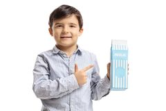 Boy with a milk carton pointing. Isolated on white background Stock Photography