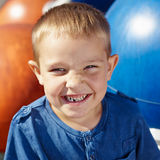 Boy and milk tooth Stock Photo