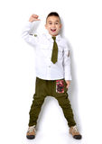 Boy in millitary t-shirt green jeans standing and giving thumbs Royalty Free Stock Photos