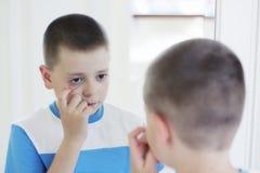 Boy at mirror Royalty Free Stock Photos