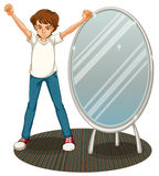 A boy beside a mirror Stock Photo