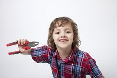 Boy with missing tooth and combination pliers. Portrait of cute boy with missing tooth and combination pliers Stock Images