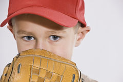 Boy with Mitt and Baseball Cap Royalty Free Stock Photography