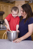 Boy mixing with mother Royalty Free Stock Photography