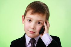 Boy with mobile phone Stock Photos
