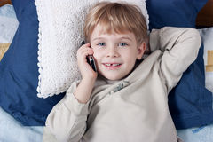 Boy with mobile phone Royalty Free Stock Image