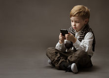 Boy with mobile phone stock photography