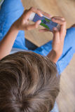 Boy with a mobile phone Stock Photography