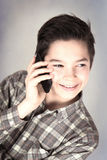 Boy at the mobile phone. Happy boy at the mobile phone Stock Photography