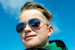 Boy with modern hair style and sunglasses Stock Photography