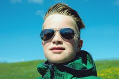 Boy with modern hair style and sunglasses Stock Photos