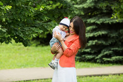 Boy with mom in the park Royalty Free Stock Photography