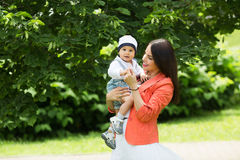 Boy with mom in the park Royalty Free Stock Photos