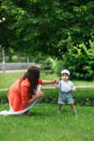 Boy with mom in the park Stock Image