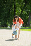 Boy with mom in the park Stock Images