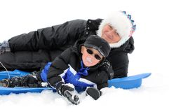 Boy and Mom Playing in Snow. Little Boy and Mom on Sled in Snow Royalty Free Stock Photography