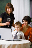 Boy and mom surfing internet Royalty Free Stock Photo