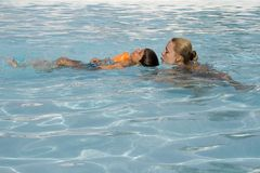 Boy and mom in the swimming po Royalty Free Stock Images