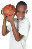 Boy with a money box Royalty Free Stock Image