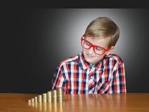 Boy with money Royalty Free Stock Photos