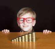 Boy with money Stock Image
