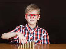Boy with money Royalty Free Stock Photography