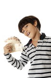 Boy and Money Royalty Free Stock Photo