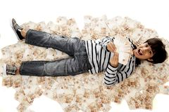 Boy and Money Stock Images