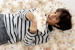 Boy and Money Stock Photos