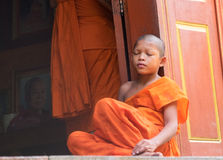 Boy monk on the steps of a Buddhist pagoda Royalty Free Stock Photos