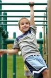 Boy on Monkey Bars. Boy crossing the monkey bars at the park Stock Photography