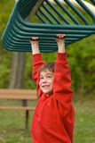 Boy on Monkey Bars royalty free stock photo